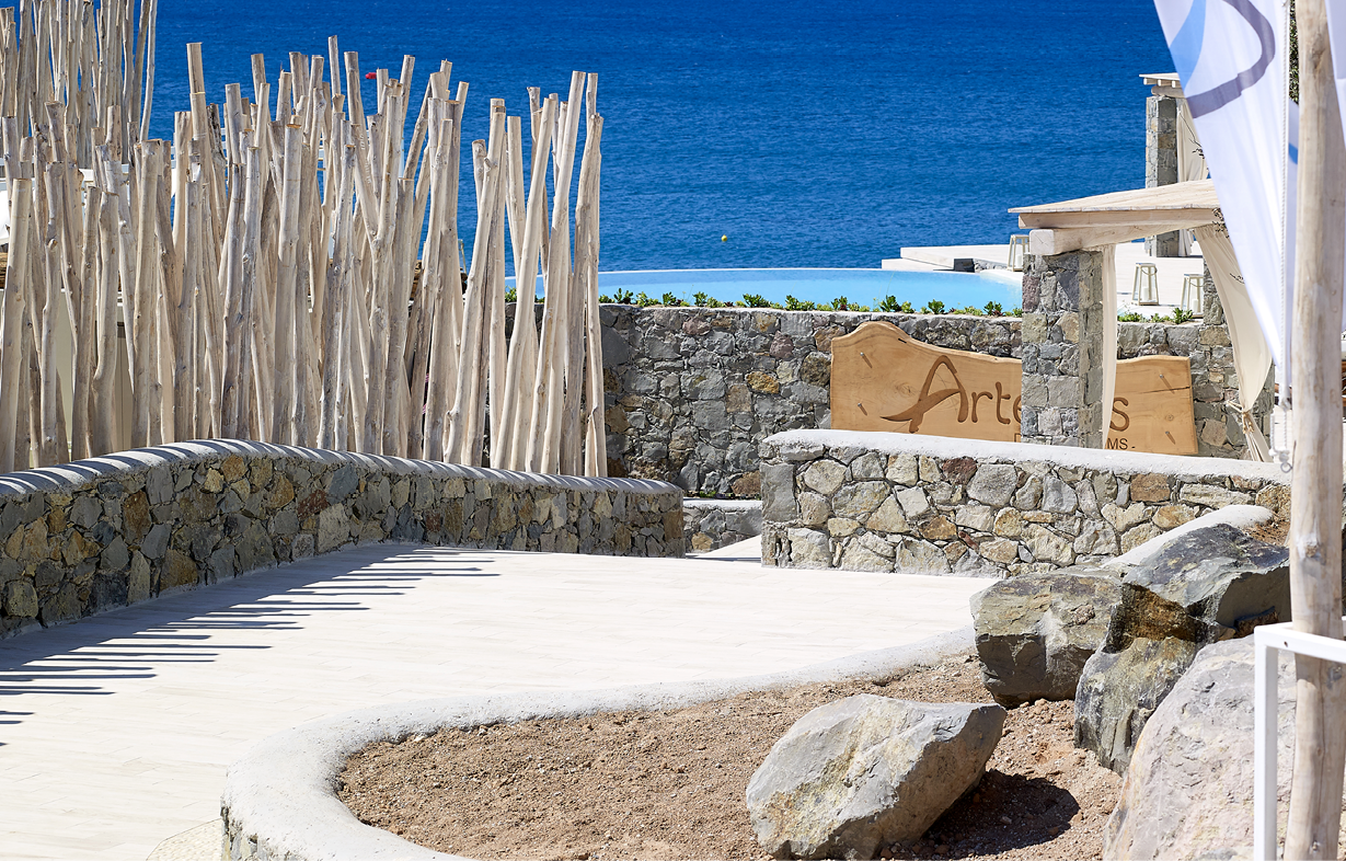 Artemis_logo_entrance_pool_bar_sea_view_sky_blue_trees_horizon_summertime__relaxation_summer_Artemis_Deluxe_Rooms_Milos_island