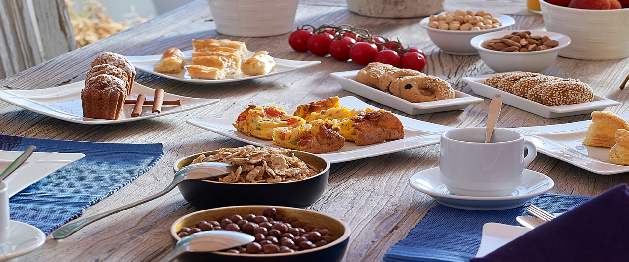 Breakfast_eating_healthy_nutritious_energy_table_gathering__delicacies_local_products_summer_sea_view_Artemis_Deluxe_Rooms_Milos_island_Cyclades1